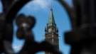 The flag on the Peace Tower on Parliament Hill in Ottawa flies at half mast on Sunday, May 30, 2021, after the remains of 215 children were found at the grounds of the former Kamloops Indian Residential School at Tk'emlups te Secwépemc First Nation in Kamloops, B.C. THE CANADIAN PRESS/Justin Tang