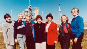 """In this 1995 file photo, members of the FLATs, also known as the Mercury 13, gather for a photo as they attend a shuttle launch in Florida. From left are Gene Nora Jessen, Wally Funk, Jerrie Cobb, Jerri Truhill, Sarah Rutley, Myrtle Cagle and Bernice Steadman. Blue Origin's Jeff Bezos has chosen Funk, an early female aerospace pioneer, to rocket into space with him later this month. The company announced Thursday, July 1, 2021, that Funk will be aboard the July 20 launch from West Texas, flying as an """"honored guest."""" Funk, along with the other women of Mercury 13, went through astronaut training in the 1960s, but never made it to space - or even NASA's astronaut corps - because of their gender. (NASA via AP)"""