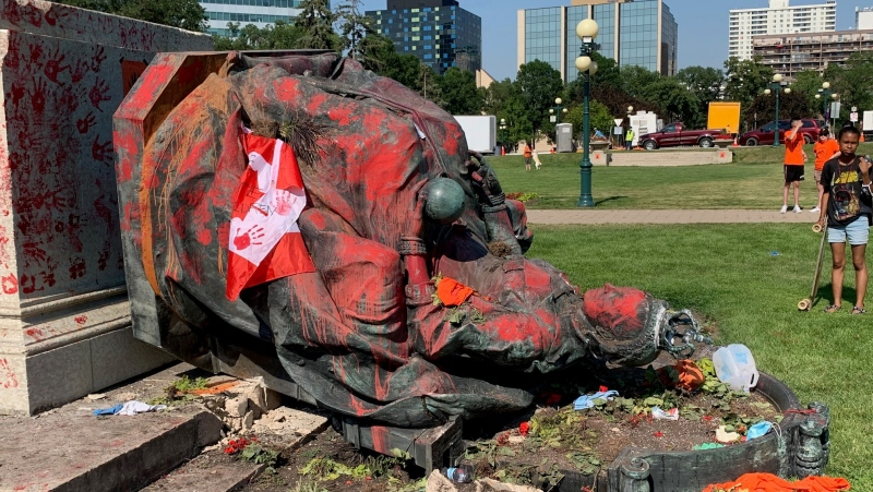 The Queen Victoria statue outside the Manitoba Legislature was taken down by demonstrators and covered in paint on Thursday, July 1, 2021. (Source: Gary Robson/CTV News)