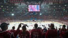 Fans cheer as the Montreal Canadiens and Tampa Bay Lightning take the ice for the pregame warmup before Game 3 of the NHL Stanley Cup finals Friday, July 2, 2021 in Montreal. THE CANADIAN PRESS/Ryan Remiorz