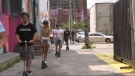 People enjoying downtown Windsor while riding scooters - Saturday July 3, 2021 (Alana Hadadean / CTV News)