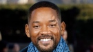 """In this Monday, Jan. 6, 2020, file photo, U.S actor Will Smith poses for photographers during the photo call of """"Bad Boys for Life,"""" in Paris. (AP Photo/Thibault Camus, File)"""