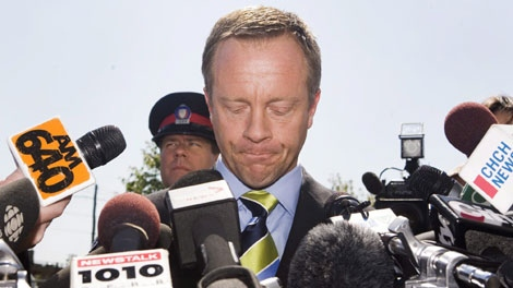 Former Ontario attorney general Michael Bryant talks to media outside the Toronto Police Traffic Services on Tuesday, September 1, 2009. (THE CANADIAN PRESS/Darren Calabrese)