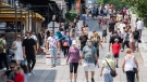 Masked pedestrians walk down Place Jacques-Cartier in Old Montreal, Sunday, July 4, 2021, as the COVID-19 pandemic continues in Canada and around the world. (THE CANADIAN PRESS/Graham Hughe)
