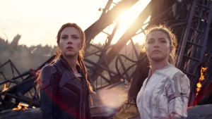 """This image released by Marvel Studios shows Scarlett Johansson, left, and Florence Pugh in a scene from """"Black Widow."""" (Marvel Studios-Disney via AP)"""