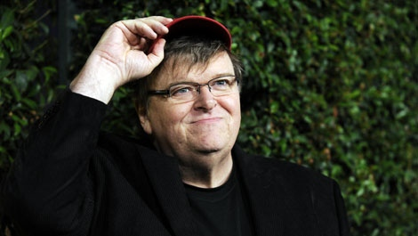"""Michael Moore, director/writer/producer/star of the documentary """"Capitalism: A Love Story,"""" arrives at a screening of the film at the Academy of Motion Picture Arts and Sciences in Beverly Hills, Calif., Tuesday, Sept. 15, 2009. (AP Photo/Chris Pizzello"""