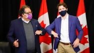 Prime Minister Justin Trudeau, right, elbow bumps with Calgary Mayor Naheed Nenshi as the two meet in Calgary, Alta., Wednesday, July 7, 2021.THE CANADIAN PRESS/Jeff McIntosh