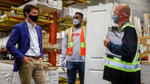 Prime Minister Justin Trudeau, left, tours the AAA Door company in Calgary, Alta., Wednesday, July 7, 2021. THE CANADIAN PRESS/Jeff McIntosh