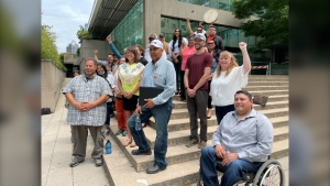 Members of the Blueberry River First Nation and their supporters celebrate a recent court ruling in downtown Vancouver on Thursday, July 8, 2021.