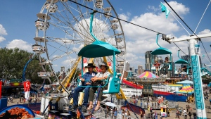 Visitors take the skyride for a high angle view during the Calgary Stampede in Calgary, Friday, July 9, 2021. THE CANADIAN PRESS/Jeff McIntosh