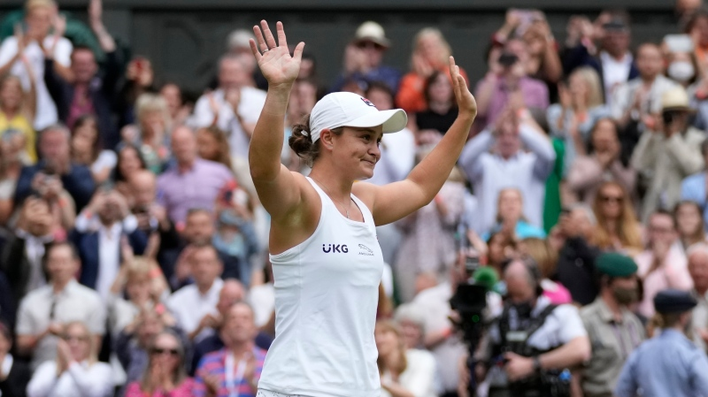 Australia's Ashleigh Barty reacts to the crowd after defeating the Czech Republic's Karolina Pliskova in the women's singles final on day twelve of the Wimbledon Tennis Championships in London, Saturday, July 10, 2021. (AP Photo/Kirsty Wigglesworth)