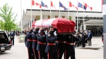 The casket of late Toronto Police Const. Jeffrey Northrup is carried by pallbearers into BMO stadium in Toronto where a funeral service is being held on Monday, July 12, 2021. THE CANADIAN PRESS/Christopher Katsarov