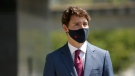 Prime Minister Justin Trudeau looks on after answering questions from reporters following a transit announcement during a press conference at Surrey City Hall in Surrey, B.C., on Friday, July 9, 2021. THE CANADIAN PRESS/Chad Hipolito