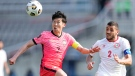 South Korea's Son Heung-min, left, fights for the ball against Lebanon's Kassem El Zein during their Asian zone Group H qualifying soccer match for the FIFA World Cup Qatar 2022 at Goyang stadium in Goyang, South Korea, Sunday, June 13, 2021. (AP / Lee Jin-man)