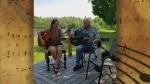 Lyn Mazonello and her dad, August, have the Goulais River as their background as they sing an old Hank Williams song, 'You Win Again.'