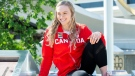 Gymnast Ellie Black smiles after receiving her official Olympic jacket during an event presenting the Canadian Olympic Artistic Gymnastics team for the Tokyo 2020 games in Montreal, Thursday, June 17, 2021. (THE CANADIAN PRESS/Graham Hughes)
