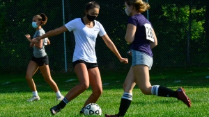 Members of the Brattleboro, Vt., Union High School's girls' varsity soccer team practice for the first time for the season on Tuesday, Sept. 8, 2020, as high school sports returns for the first time since the COVID-19 pandemic canceled the Spring season. (Kristopher Radder/The Brattleboro Reformer via AP)