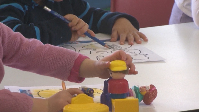This file photo shows children playing and colouring at their child care facility.