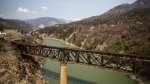 A rail bridge damaged by fire is seen in Lytton, B.C., on Friday, July 9, 2021, after a wildfire destroyed most of the village on June 30. (Darryl Dyck  / THE CANADIAN PRESS)