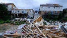 Damage left after a tornado touched down in a neighbourhood of Barrie, Ont., on Thursday, July 15, 2021. (THE CANADIAN PRESS/Christopher Katsarov)