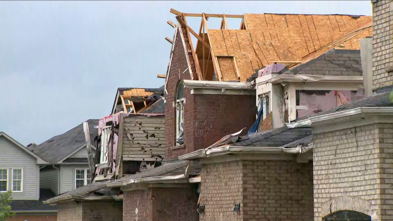Damaged rooftops are pictured after a suspected tornado touched down in Barrie, Ont. Thursday, July 15, 2021.