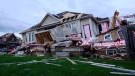 Damage left after a tornado touched down in a neighbourhood in Barrie, Ont., on Thursday, July 15, 2021. THE CANADIAN PRESS/Christopher Katsarov