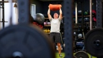 Paul Roberston works out at Crossfit Bytown as patrons return to the gym as Ontario enters phase 3 of reopening during the COVID-19 pandemic in Ottawa on Friday, July 16, 2021. (Sean Kilpatrick/THE CANADIAN PRESS)