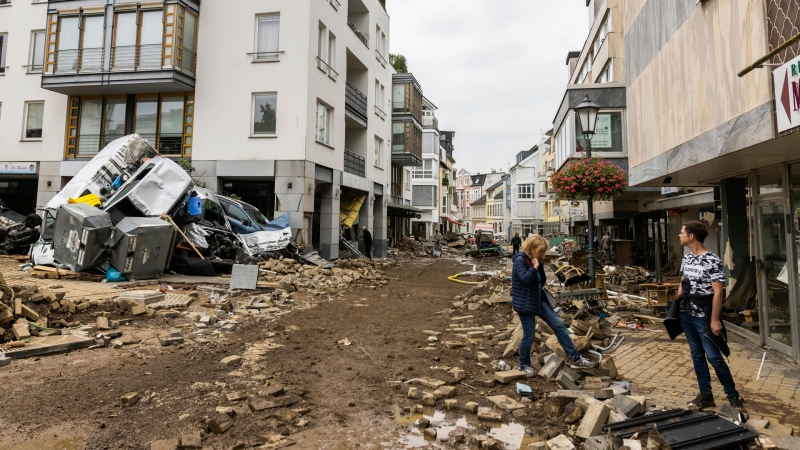Damaged possessions line a street in Bad Neuenahr, Germany, Friday July 16, 2023, after heavy rains caused mudslides and flooding in the western part of Germany. (Philipp von Ditfurth/dpa via AP)