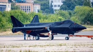 Hidden under tarpaulin, a prospective Russian fighter jet is being towed to a parking spot before its presentation at the Moscow international air show in Zhukovsky outside Moscow, Russia, Thursday, July 15, 2021. (AP Photo/Ivan Novikov-Dvinsky)