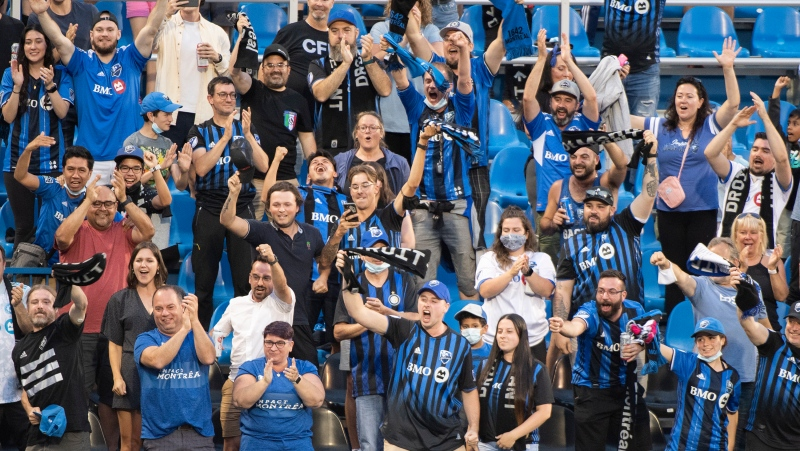 CF Montreal fans celebrate a goal during first half MLS soccer action against FC Cincinnati in Montreal, Saturday, July 17, 2021. THE CANADIAN PRESS/Graham Hughes