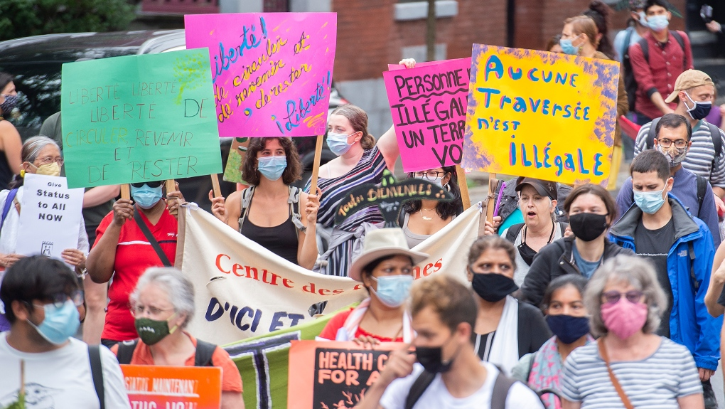 Protesters demand status for all