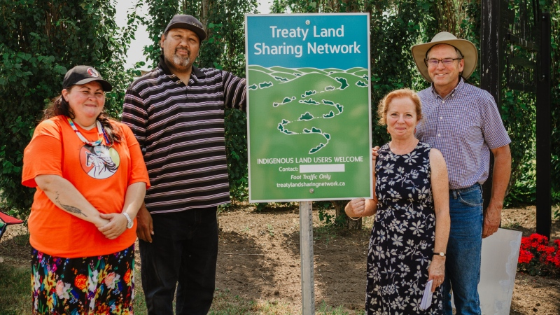 Mary Smillie and Ian McCreary post the first Treaty Land Sharing Network sign at their farm in Bladworth, Sask., accompanied by Treaty Commissioner Mary Culbertson and Bradley Desjarlais from the Anishnabek Nation Treaty Authority. (Courtesy: Breeana Kateri)