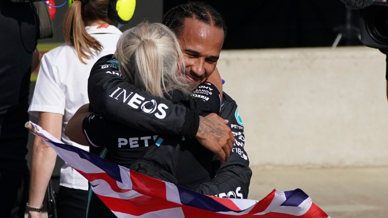 Mercedes driver Lewis Hamilton of Britain celebrates after winning the British Formula One Grand Prix, at the Silverstone circuit, in Silverstone, England, Sunday, July 18, 2021. (AP Photo/Jon Super)