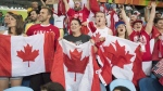 Fans of Erica Wiebe react during her gold medal match against in the women's 75kg women's freestyle wrestling at the 2016 Summer Olympics in Rio de Janeiro, Brazil, Thursday, Aug. 18, 2016. (THE CANADIAN PRESS / Ryan Remiorz)