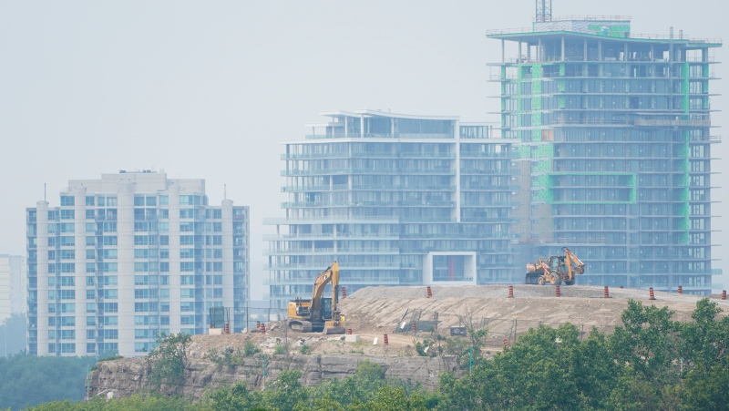The city of Gatineau, Quebec is shrouded in smoke from wildfires as construction machinery work at Nepean Point in Ottawa on Monday, July 19, 2021. (Sean Kilpatrick/THE CANADIAN PRESS)