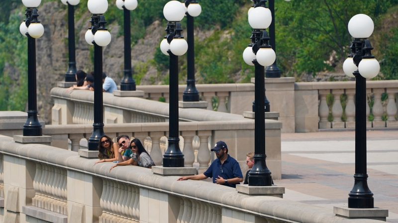 People look off the path alongside the Chateau Laurier in Ottawa on Monday, July 19, 2021. (Sean Kilpatrick/THE CANADIAN PRESS)