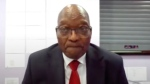 In this frame grab former South Africa President Jacob Zuma, appears on a screen virtually from the correctional service facility Estcourt, in Pietermaritzburg, South Africa, Monday July 19, 2021, where his corruption trial resumes. (South Africa Judiciary via AP)