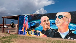 The side of a building in Van Horn, Texas, is adorned with a mural of Blue Origin founder Jeff Bezos, on July 17, 2021. (Sean Murphy / AP)