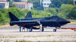 A prospective Russian fighter jet is being towed to a parking spot before its presentation at the Moscow international air show, on July 15, 2021.  (Ivan Novikov-Dvinsky / AP)