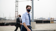 Prime Minister Justin Trudeau leaves a press conference held in Brampton, Ont., on Monday, July 19, 2021. THE CANADIAN PRESS/Christopher Katsarov