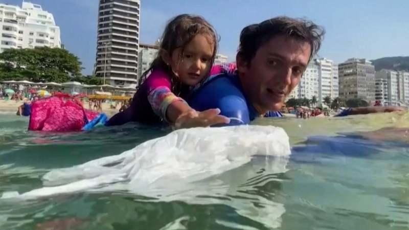 Little girl clears plastic waste from the ocean