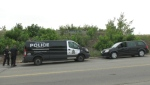 Edmonton police officers saw a man fall to the ground from the hood of a moving Dodge Caravan after it abruptly braked, according to an EPS spokesperson. (Darcy Seaton/CTV News Edmonton)