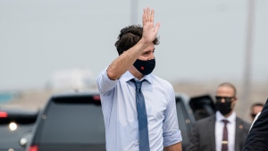 Prime Minister Justin Trudeau greets members of the press before making an announcement at a press conference in Brampton, Ont., on Monday, July 19, 2021. THE CANADIAN PRESS/Christopher Katsarov