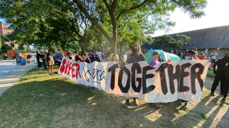 Protesters are seen at an encampment site at Lamport Stadium on Wednesday, July 21. (Brian Weatherhead/CTV News)