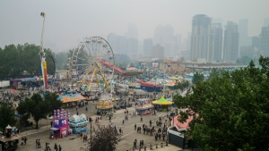 Visitors to the Stampede had to cope an Air Quality Health Index of 10 with wildfire smoke blowing into Calgary, Alta., Sunday, July 18, 2021. (THE CANADIAN PRESS / Jeff McIntosh)