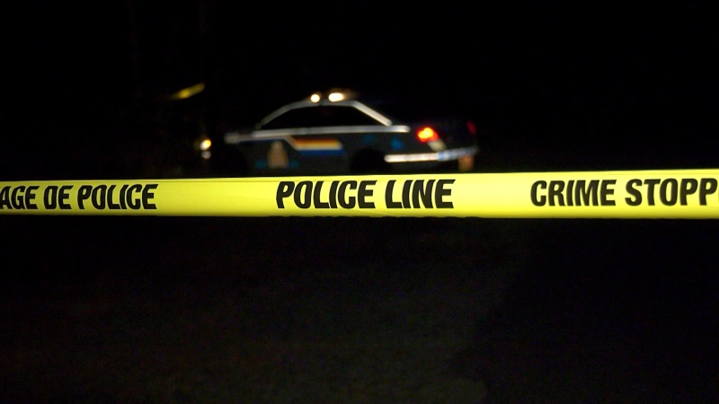 A police line is seen at a crime scene in Langley, B.C., on July 21, 2021.