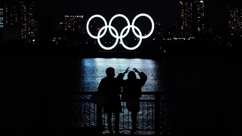 Olympic rings float in the water in the Odaiba section in Tokyo, on Dec. 1, 2020. (Eugene Hoshiko / AP)