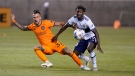 Houston Dynamo forward Maximiliano Urruti (37) and Vancouver Whitecaps midfielder Janio Bikel (19) vie for the ball during the first half during an MLS soccer match Tuesday, July 20, 2021, in Sandy, Utah. (AP / Rick Bowmer)