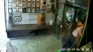 A security camera caught the moment a Montreal couple crashed through the front door of a barbershop, in a spontaneous make out session.