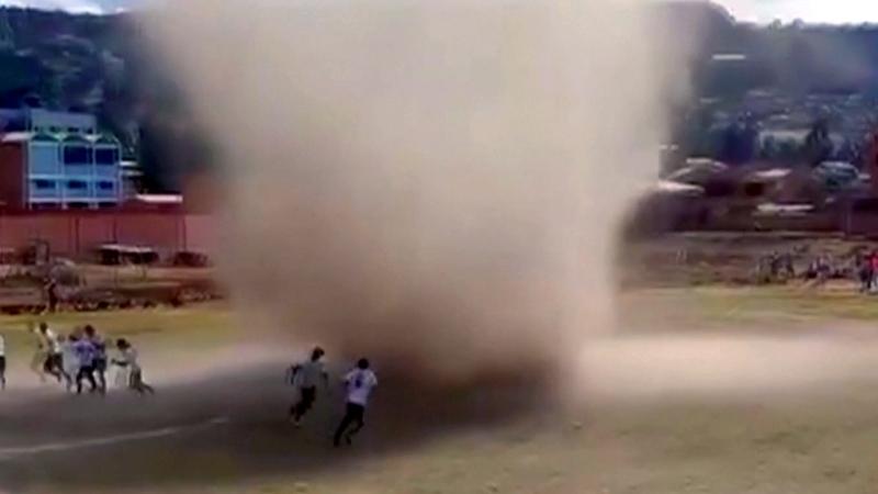 'Dust devil' rolls through Bolivian soccer game
